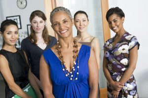 Women supporting women Group of businesswomen in an office smiling