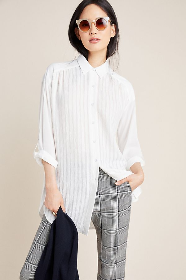 The White shirt gets a twist with front pleats