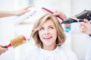 How to style thinning hair with cut, products, and hair tricks.