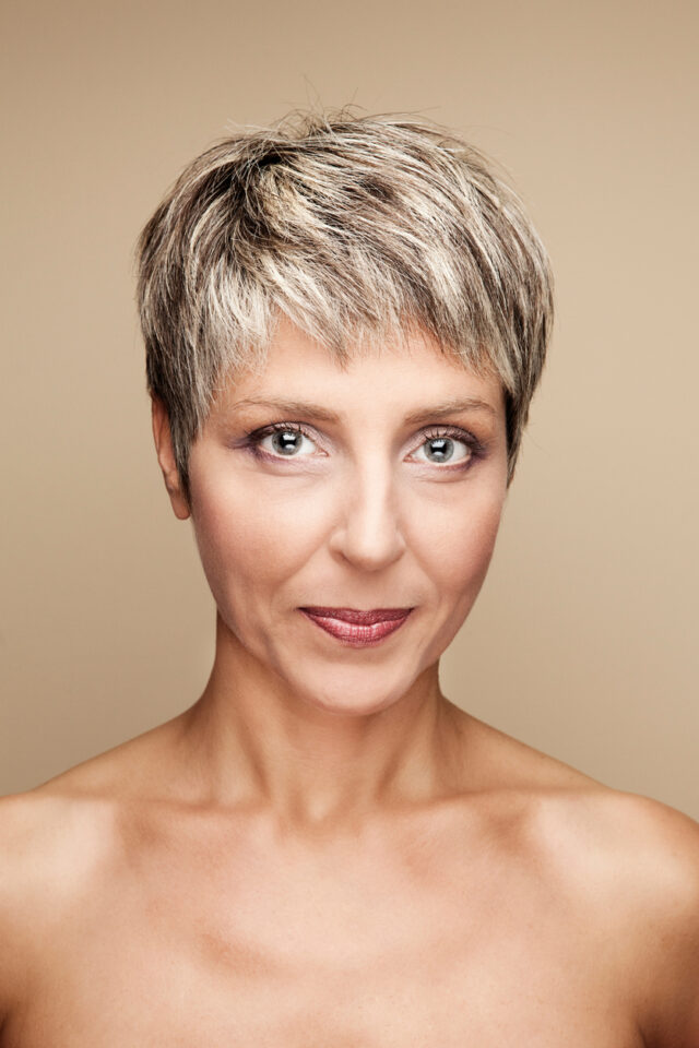 Woman with a pixie haircut to help hide thinning hair