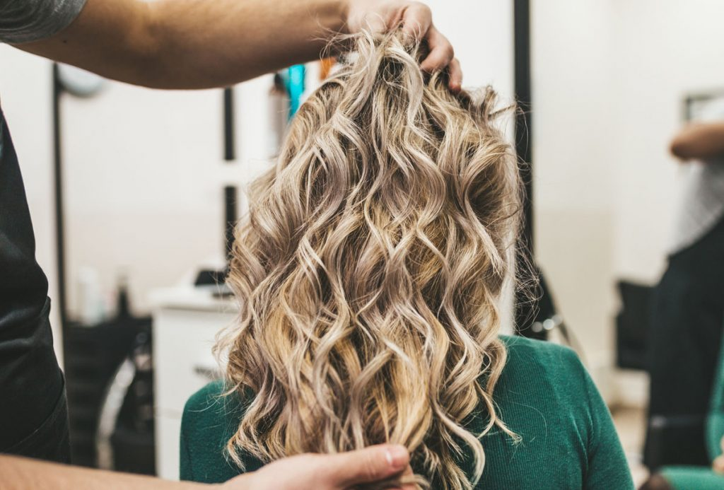 tame curly hair frizz