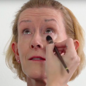 Showing how to apply concealer for women over 50