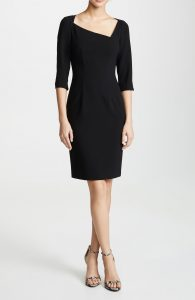 The asymmetrical neckline adds visual interest to this classic dress.