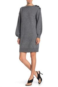This casual sweater dress has button detailing.