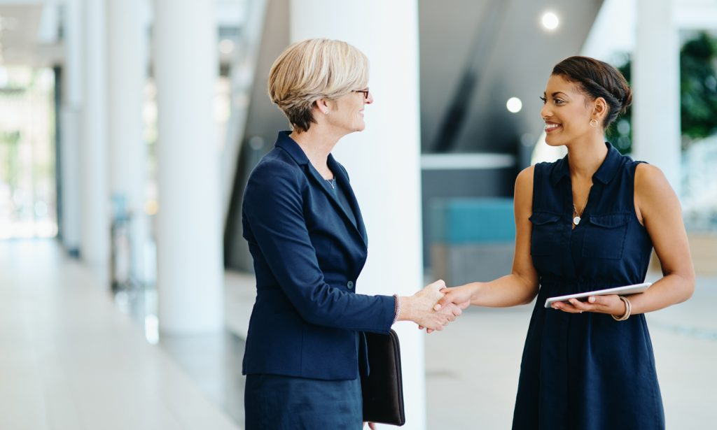 women in the workplace helping each other