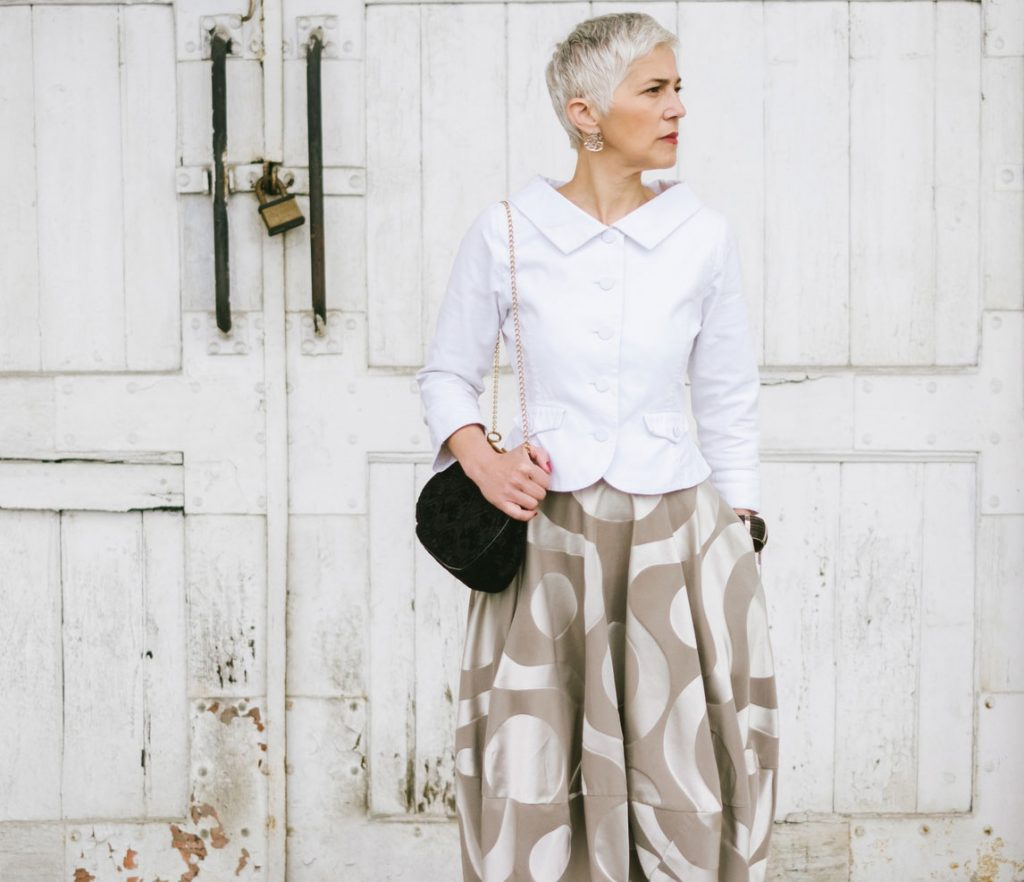 beautiful woman with gray hair wearing a white shirt
