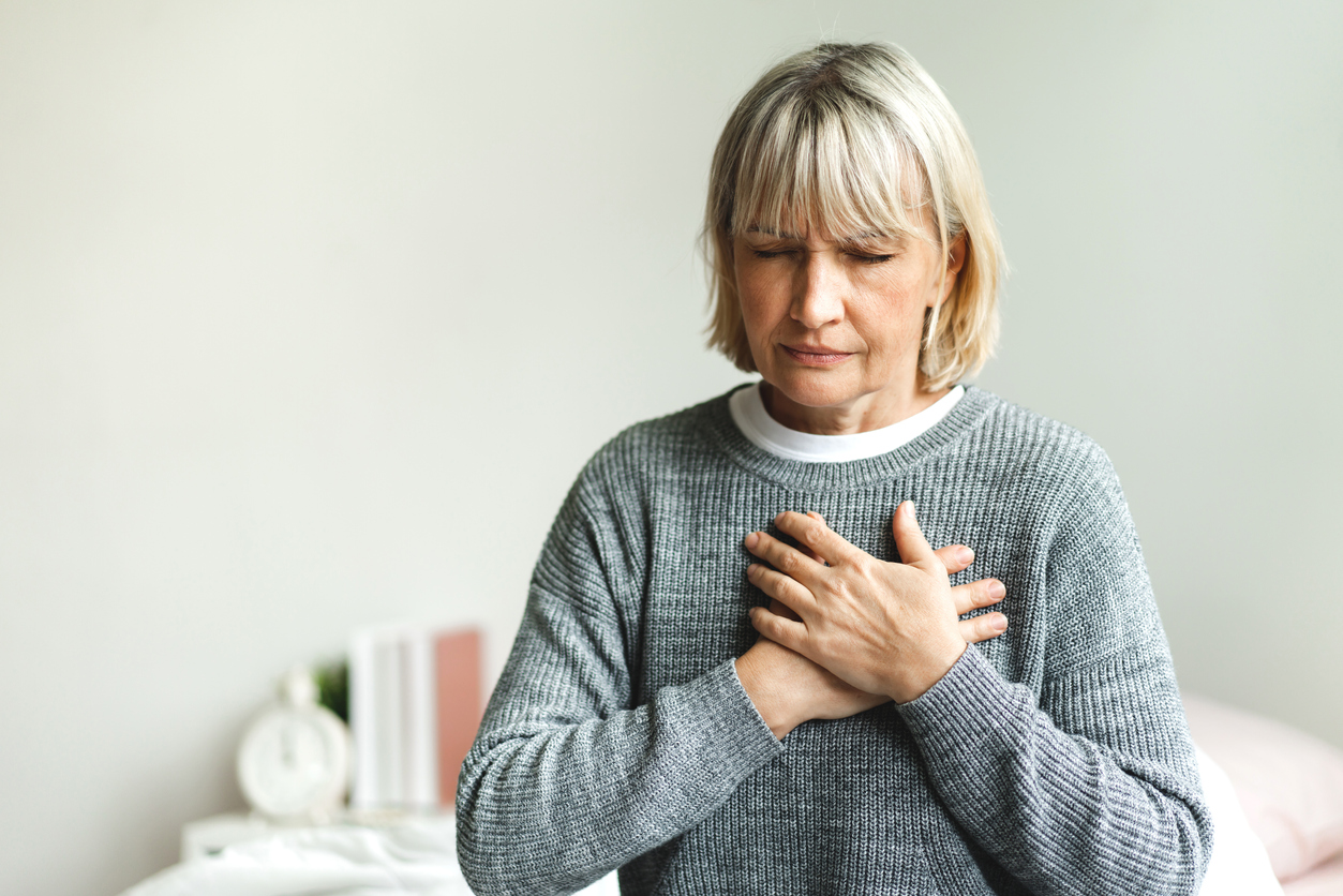 woman experiencing chest pain needs to have a heart test done. Stress test vs echocardiogram