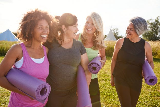Women smiling while working out getting ready to exercise