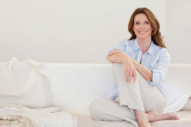 Mature woman sitting on couch