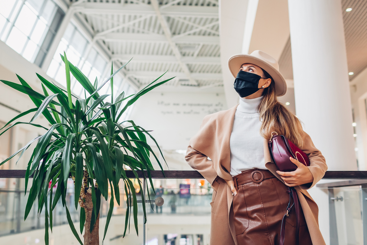 Fall wardrobe essentials to buy now - woman in mask at mall