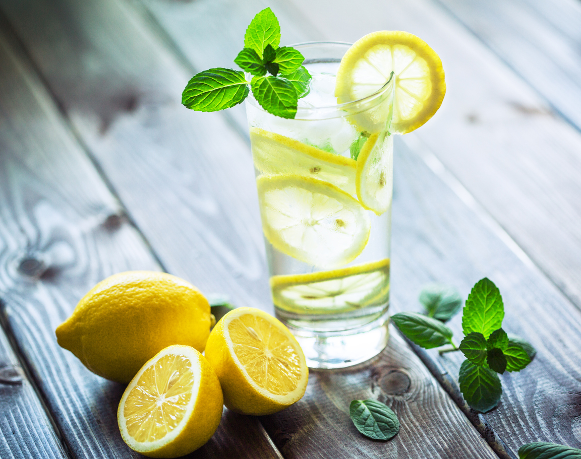 A glass of water with lemon and mint