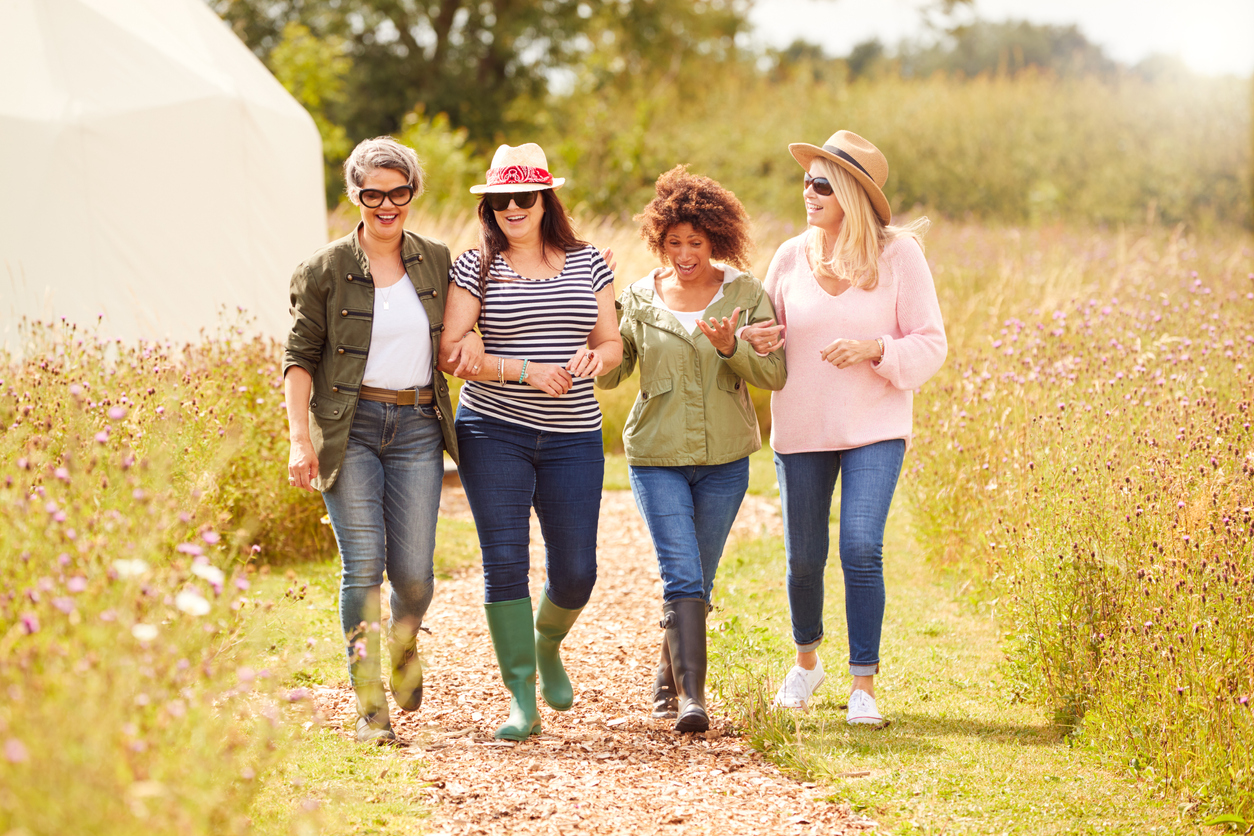 Fun things to do with friends over 50 - out for a walk at a campsite