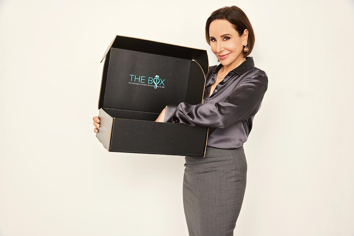Dr. Ava Shamban with a box by Dr. Ava