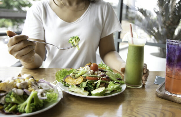 Woman eating a meal built around the keto diet