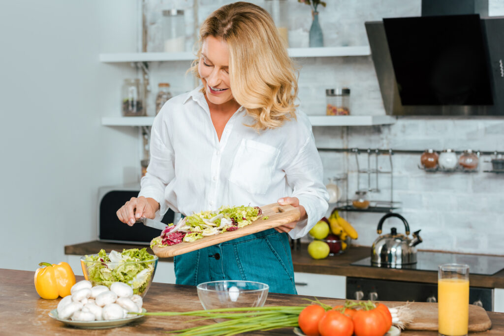 The longevity diet includes healthy foods; pic of woman cooking