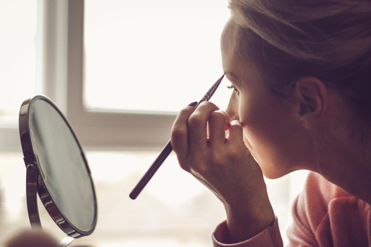 Woman using eyebrow makeup
