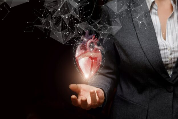 Woman holding image of a heart
