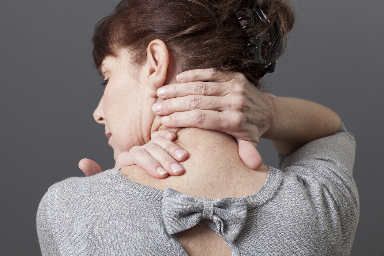 Woman rubbing neck from neck pain