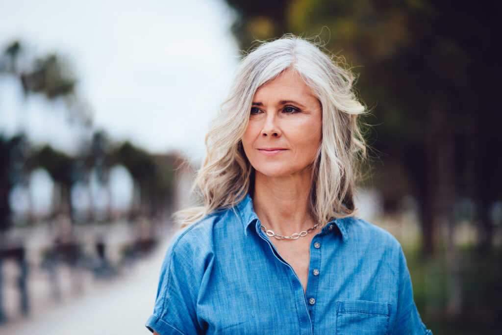 Beautiful woman with gray hair makeover