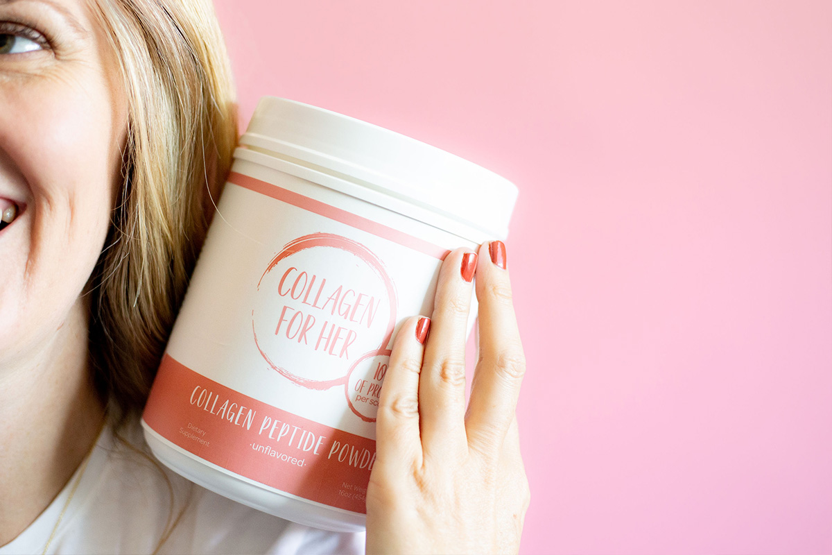 Collagen for her woman holding Peptide Powder