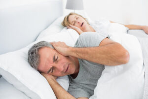 menopause and snoring, couple in bed