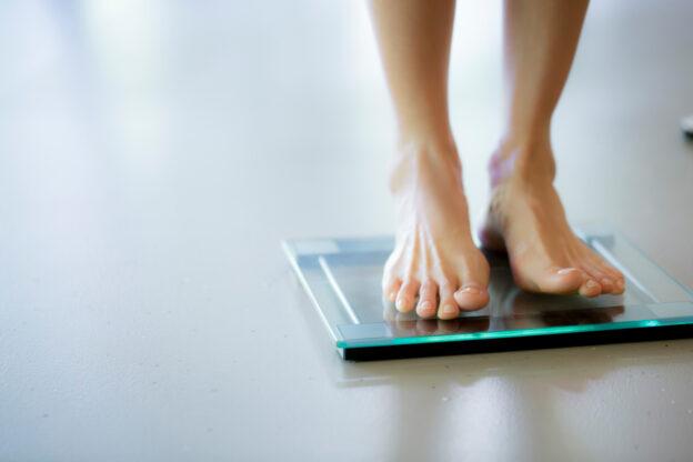 Healthy body fat percentage woman on scale