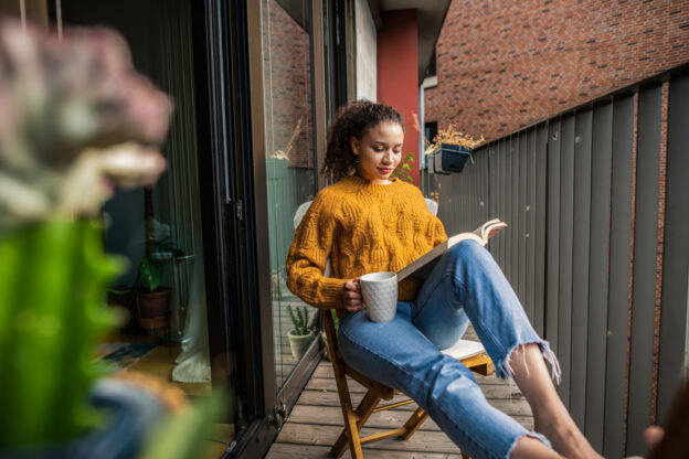 Woman reading a book for the October reading list