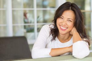 Asian woman smiling - ProBiora Health oral care